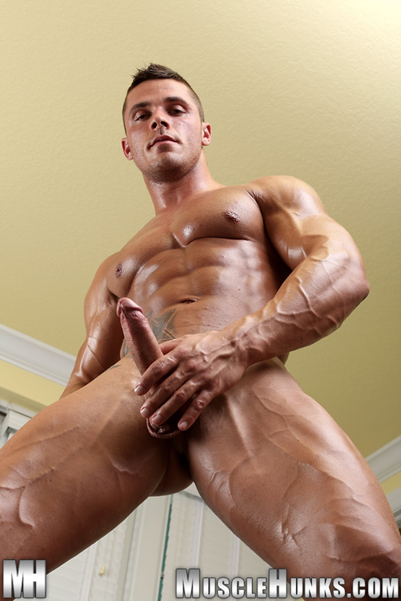 image Muscle boy jerking off his uncut cock