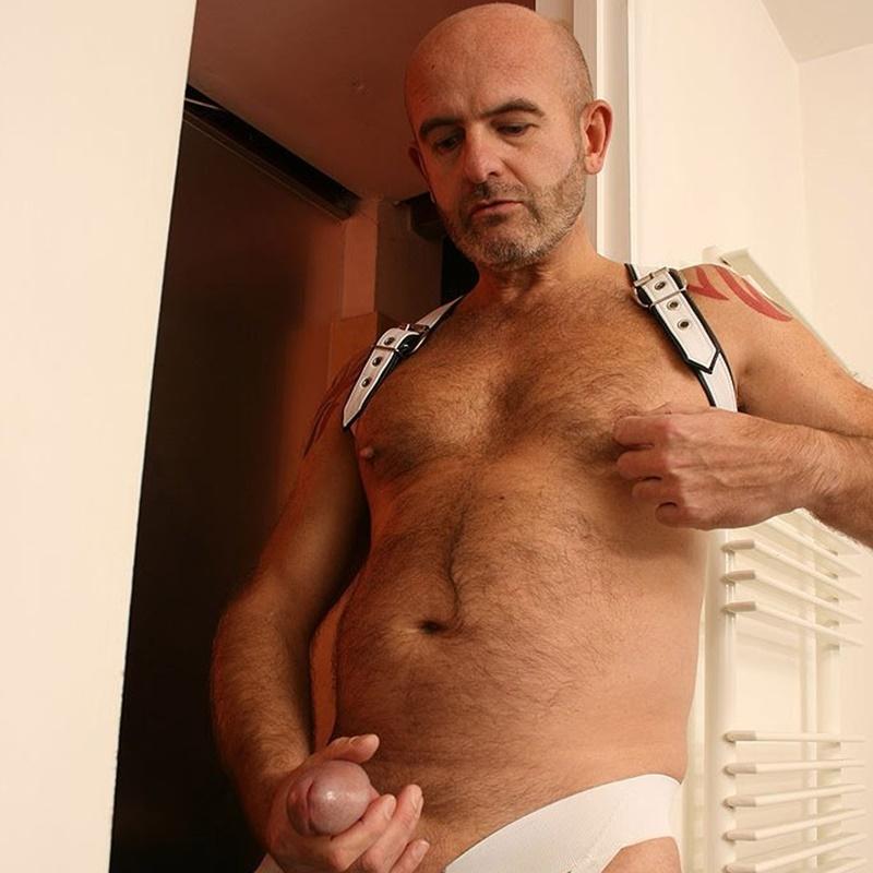 Bald gay jerking off photo